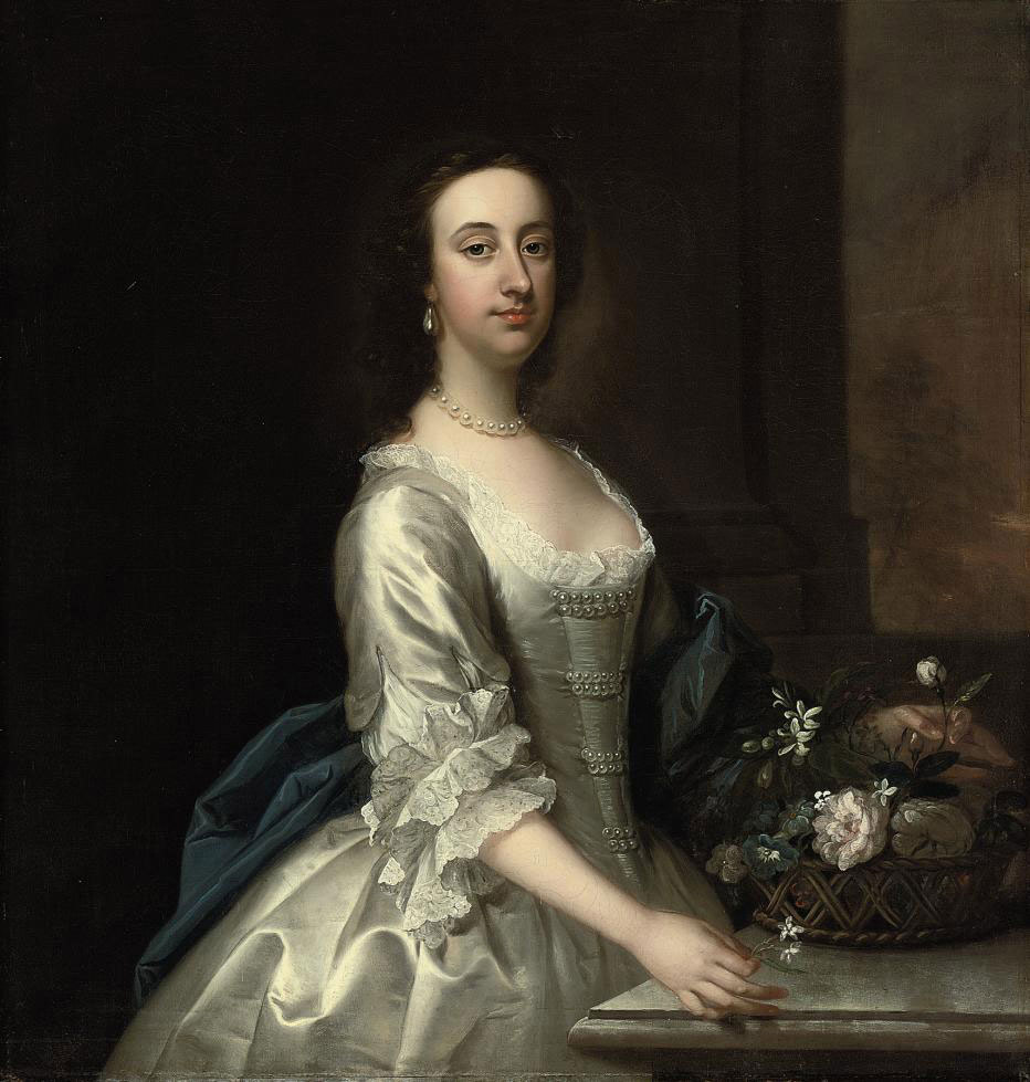 Portrait of a lady, three-quarter-length, in a lace-trimmed satin oyster dress with pearl ornaments and blue wrap, beside a ledge with a basket of flowers