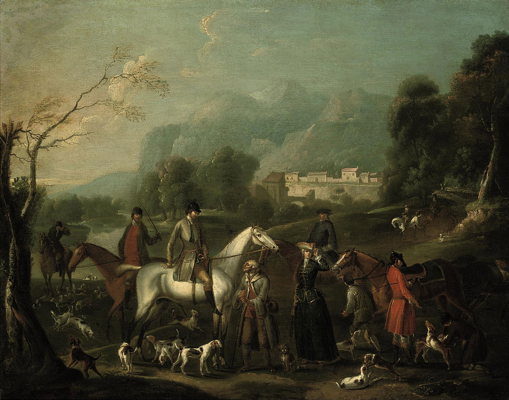 A wooded river landscape with a hunting party at rest