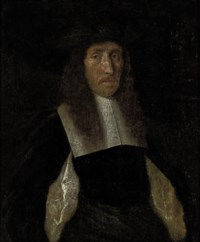 Portrait of a gentleman, half-length, in a black slashed doublet and black hat