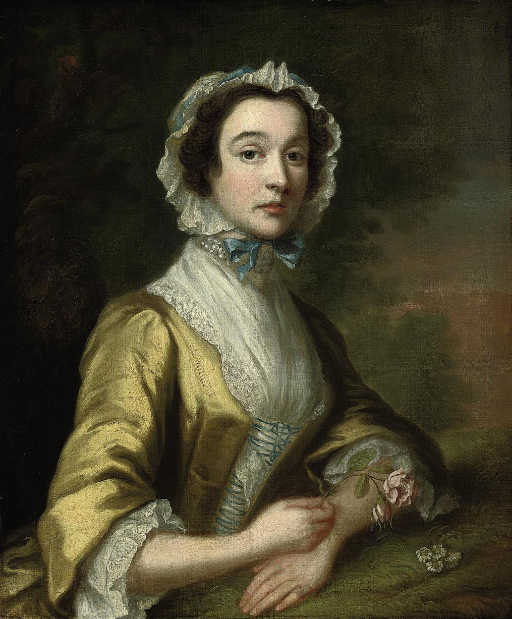 Portrait of a lady, half-length, in a lace trimmed yellow dress with a lace cap, a rose in her right hand, her left hand resting on a mossy bank, a landscape beyond
