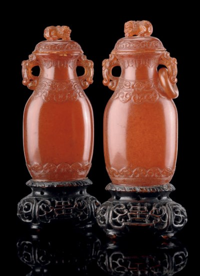 A PAIR OF AMBER VASES AND COVE