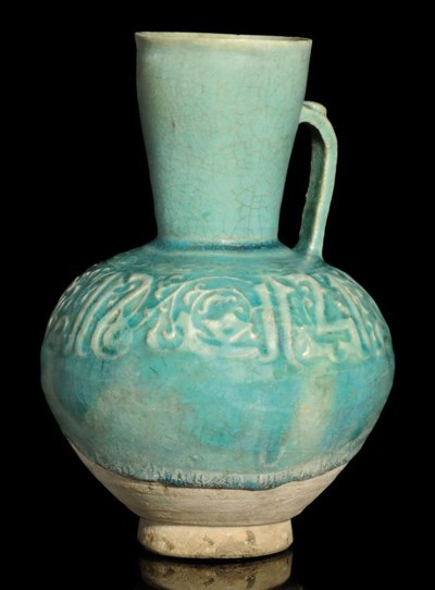 A TURQUOISE GLAZED MOULDED POT