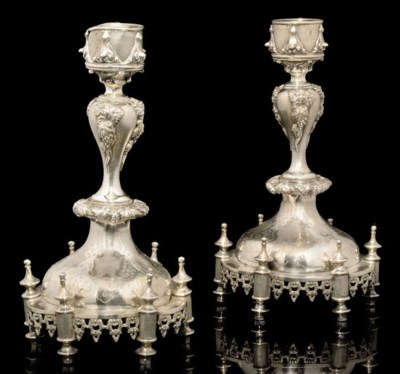 A PAIR OF ENGRAVED SILVER CAND