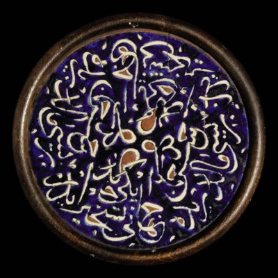 AN IZNIK POTTERY ROUNDEL WITH