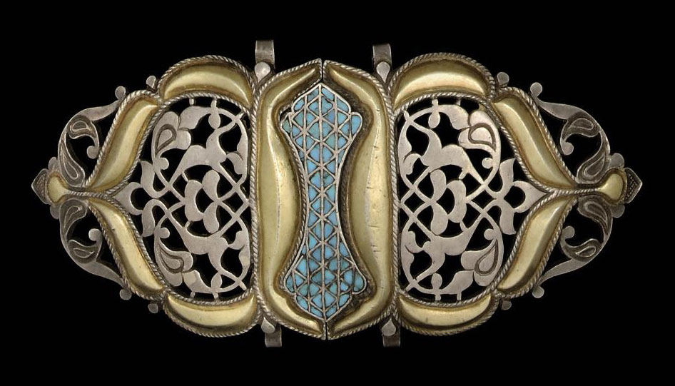 A TURQUOISE INLAID SILVER AND