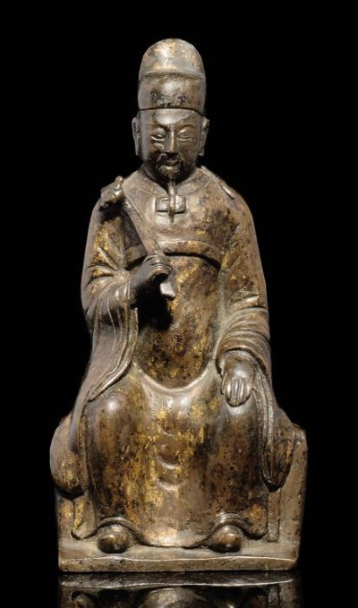 A BRONZE SEATED OFFICIAL