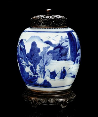 A BLUE AND WHITE JAR WITH WOOD