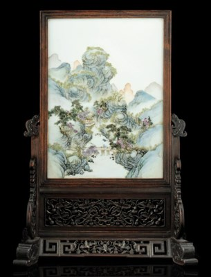 A PORCELAIN PLAQUE MOUNTED WIT