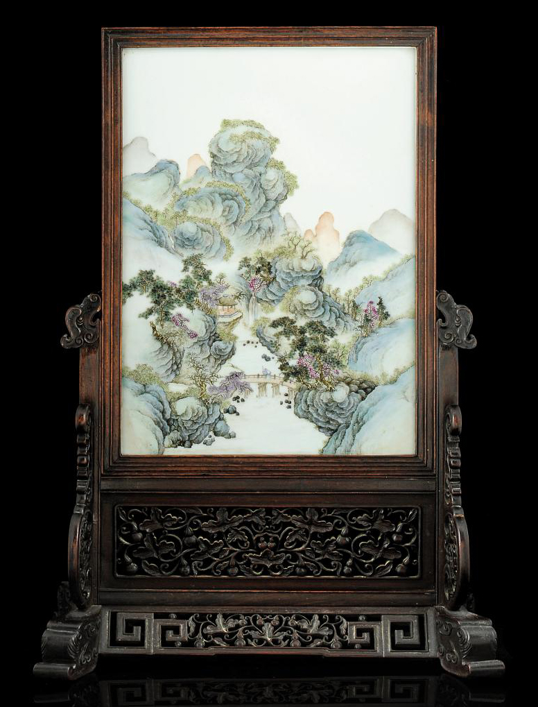 A PORCELAIN PLAQUE MOUNTED WITHIN A WOODEN TABLE SCREEN