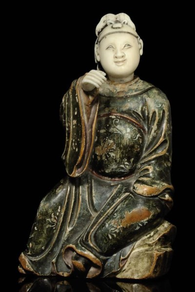 AN IVORY AND WOODEN FIGURE OF