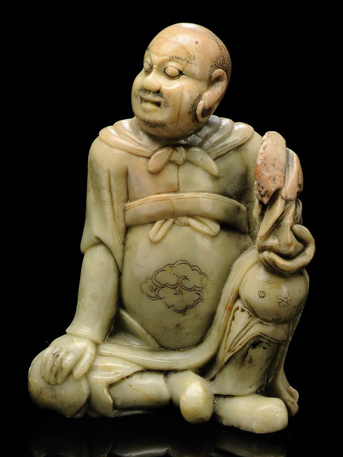 A SOAPSTONE CARVING OF BODHIDH