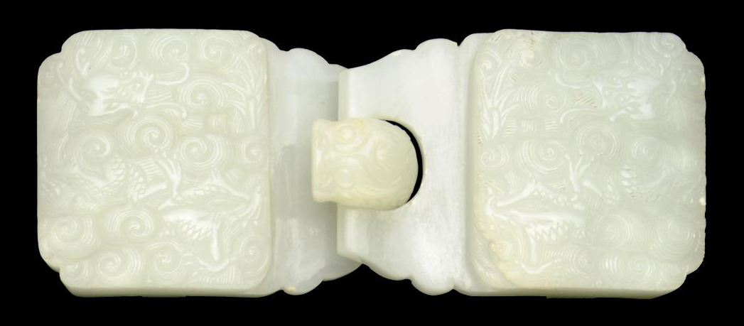 A WHITE JADE TWIN SECTIONED BE