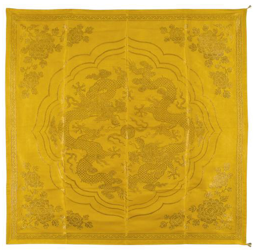 A YELLOW SATIN SCROLL COVER