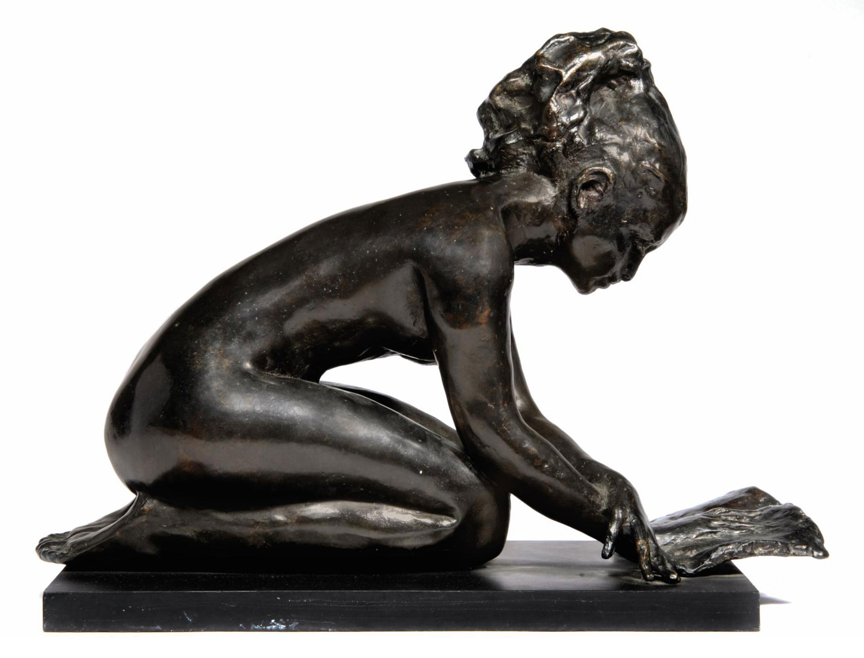 Seated nude reading