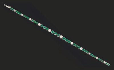An emerald and diamond line br