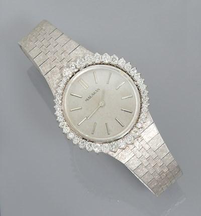 A diamond set wristwatch, by M