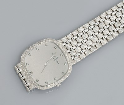 A diamond quartz wristwatch, b