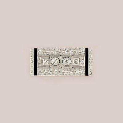 An Art Deco  diamond and onyx