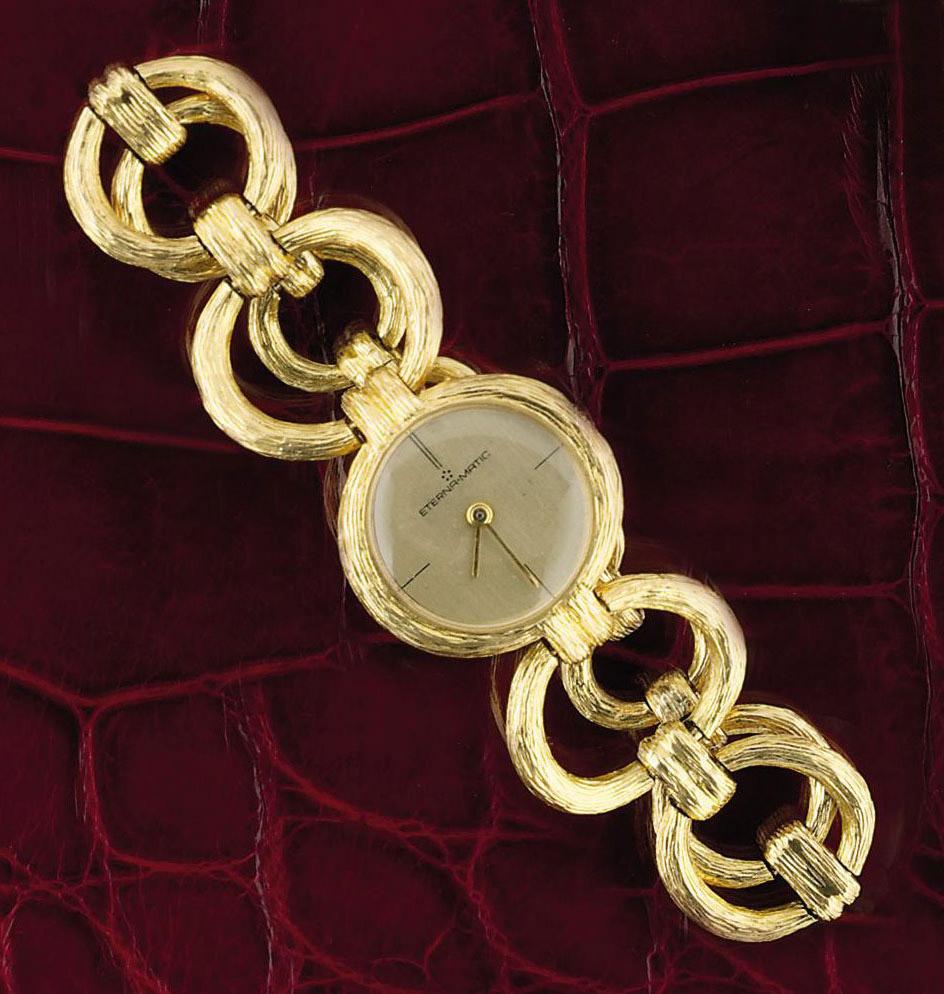 "An 18ct. gold ""eternamatic"" wristwatch, by Eterna"