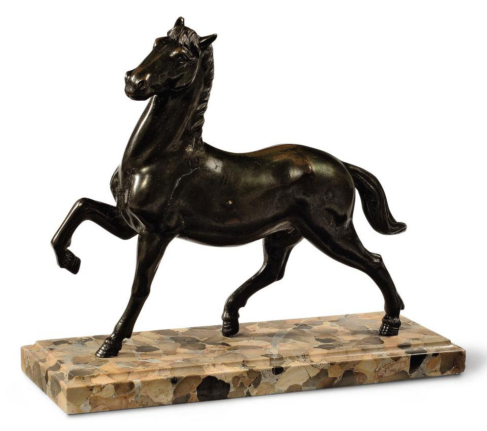 A BRONZE MODEL OF A PRANCING H