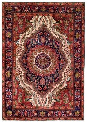 A pair of Tabriz carpets