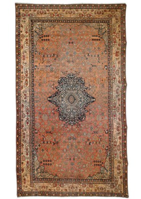 An antique Khotan carpet and a
