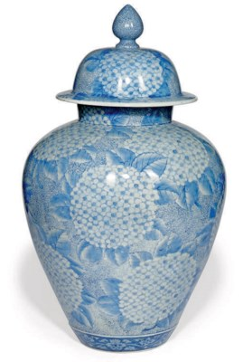 A LARGE JAPANESE JAR AND COVER