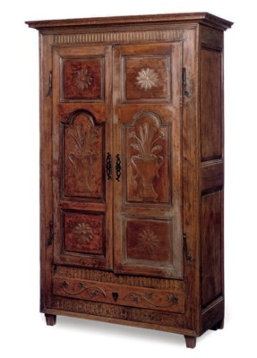 A FRENCH CARVED BEECH ARMOIRE