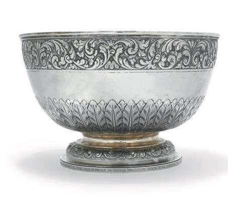 A SILVER PUNCH BOWL CHASED IN