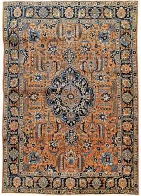 An antique Tabriz carpet