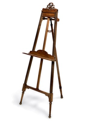 A FRENCH CARVED WALNUT EASEL