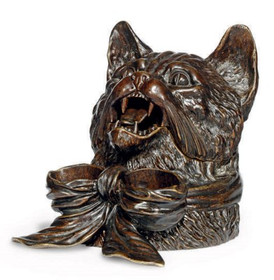 A NOVELTY BRONZE INKWELL FORME