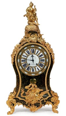 A LOUIS XV ROSEWOOD AND BRASS