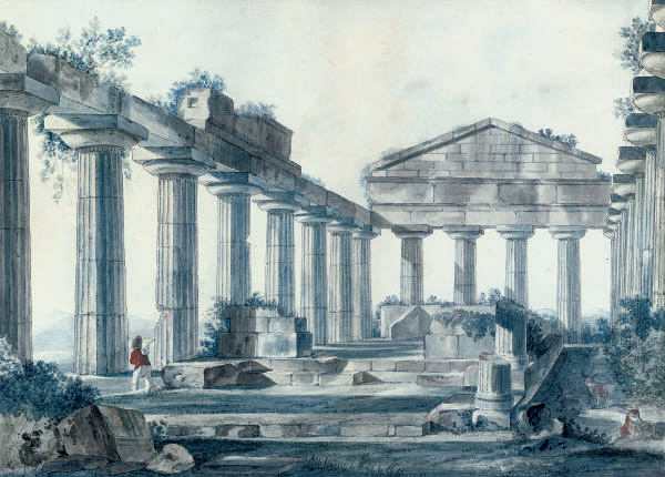 A ruined temple with a traveller in the foreground