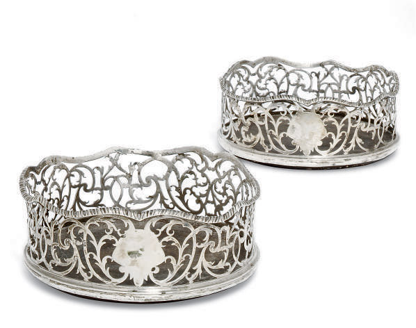 A PAIR OF GEORGE III SILVER WINE COASTERS