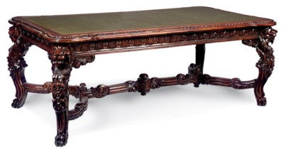 A CARVED WALNUT LIBRARY TABLE