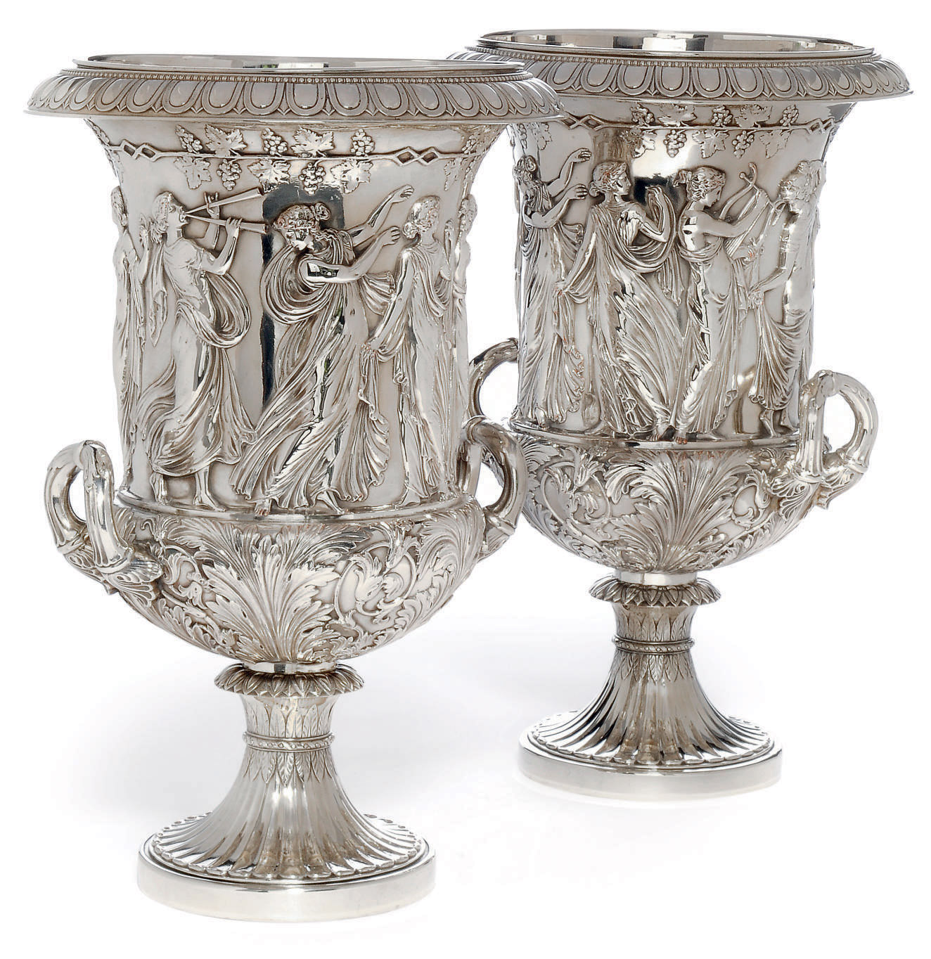 A LARGE AND IMPOSING PAIR OF GERMAN SILVER PLATED ON COPPER WINE COOLERS