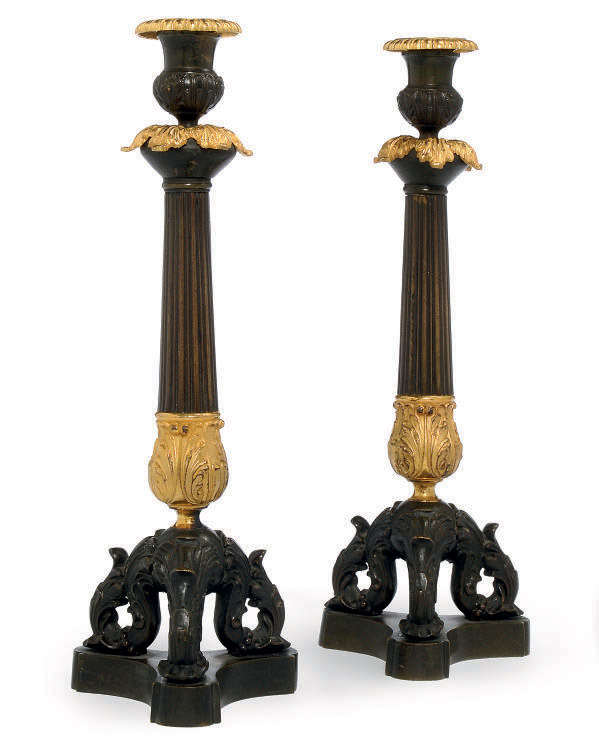 A PAIR OF RESTAURATION GILT AND PATINATED BRONZE CANDLESTICKS