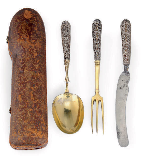 A GERMAN PARCEL-GILT SILVER TRAVELLING KNIFE, FORK & SPOON