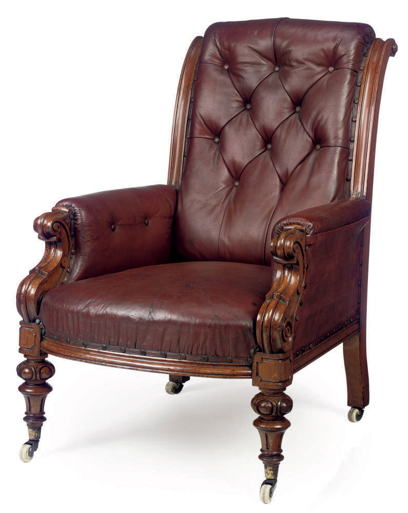 A MID-VICTORIAN BUTTONED LIBRARY ARMCHAIR