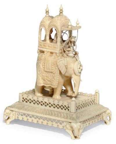 AN INDIAN IVORY ELEPHANT HOWDA