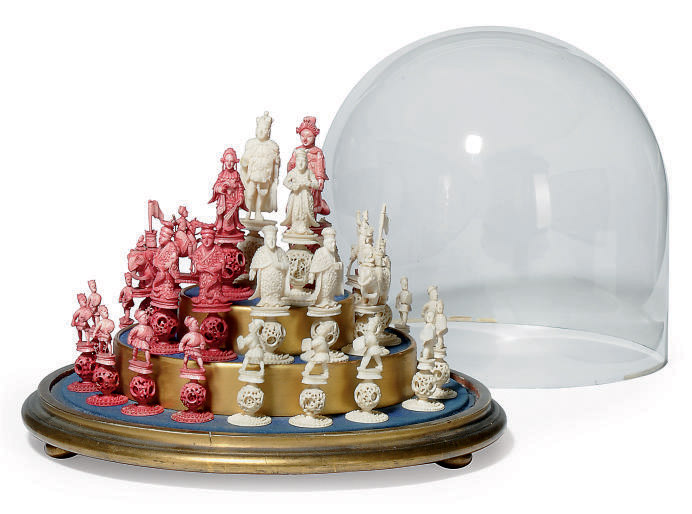 A CHINESE EXPORT CARVED IVORY AND STAINED IVORY PUZZLE BALL CHESS SET
