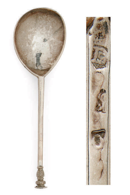 A JAMES I PARCEL-GILT SILVER SEAL-TOP SPOON