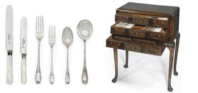 A SILVER CANTEEN OF CHIPPENDAL