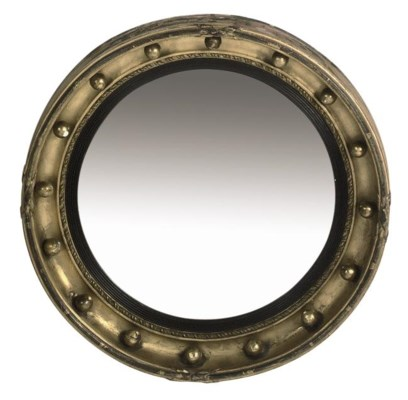 A GILTWOOD AND EBONISED CONVEX