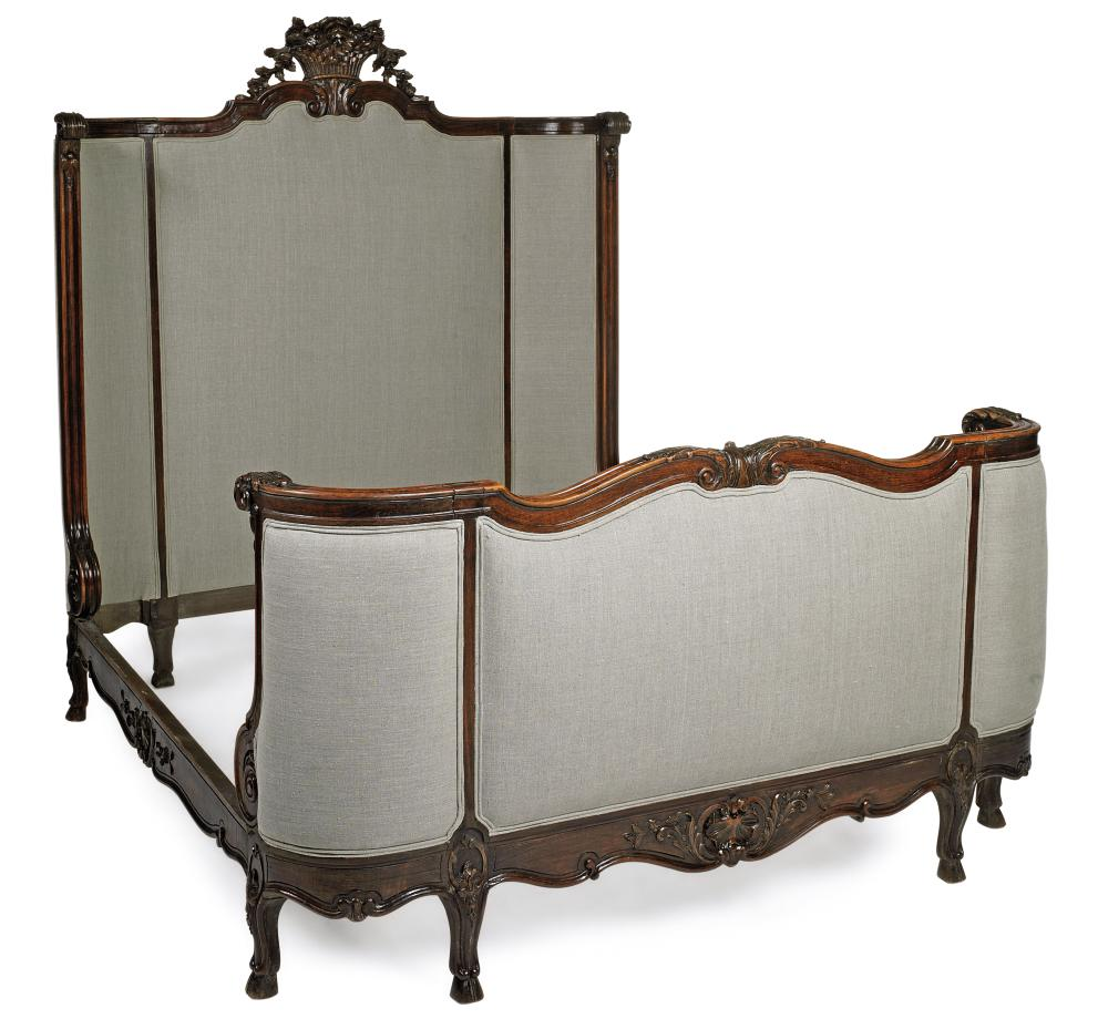 A FRENCH CARVED OAK DOUBLE BED