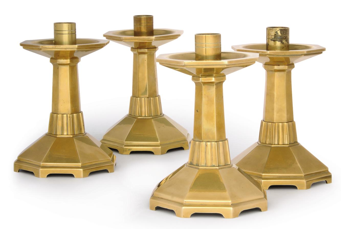 A SET OF FOUR BRONZE CANDLESTI