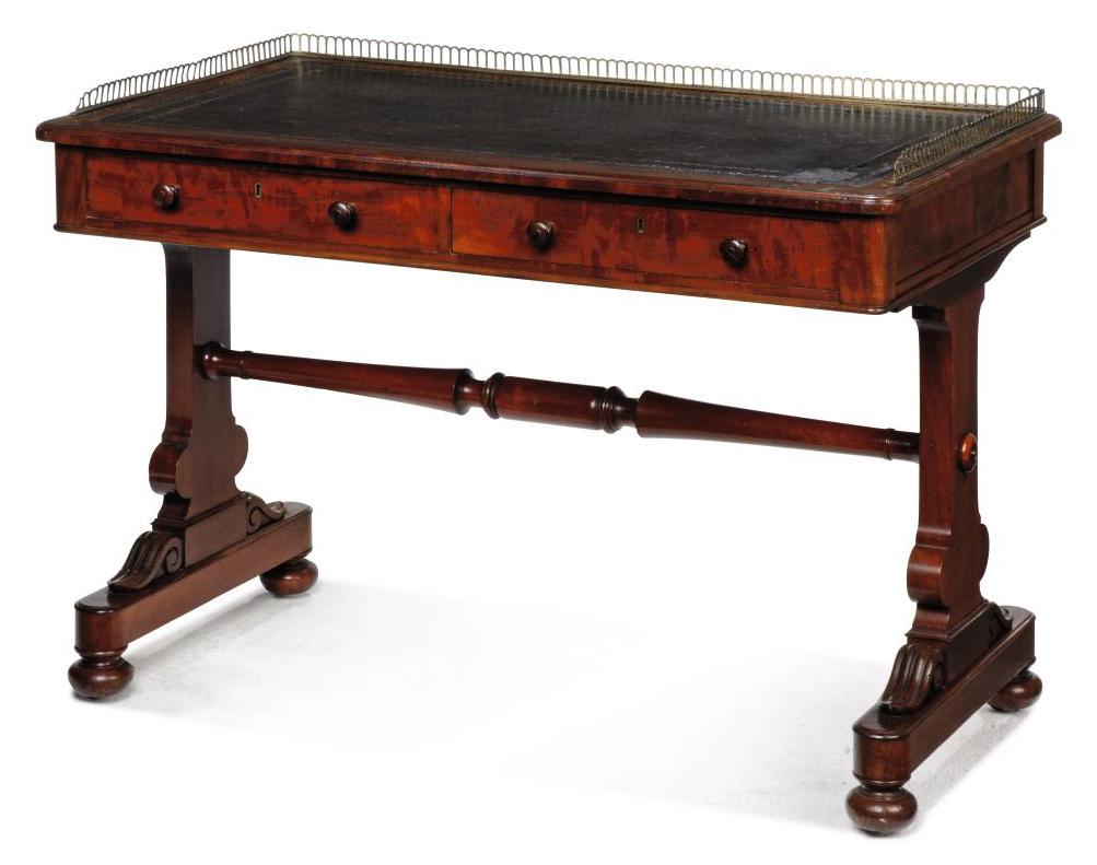 AN EARLY VICTORIAN MAHOGANY WRITING TABLE