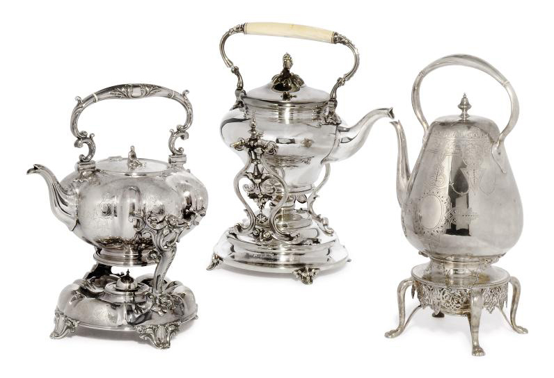 THREE SILVER-PLATED KETTLES ON STANDS