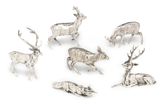 A GROUP OF SIX SMALL CONTINENTAL METALWARE TABLE ORNAMENTS MODELLED AS DEER AND A FOX